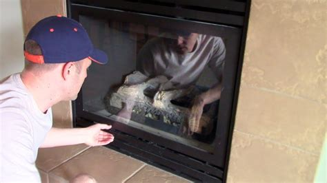 How open & remove to clean the glass cover on a GAS